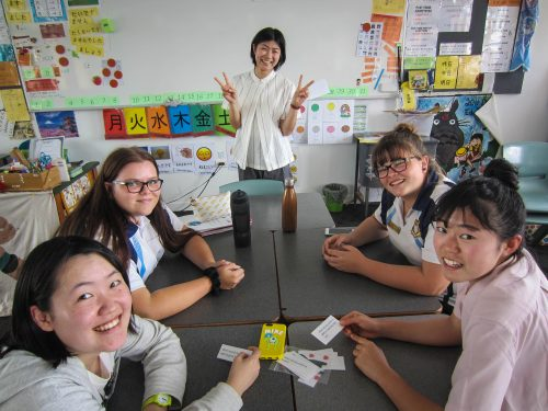 Four students in class with teacher teaching Japanese.