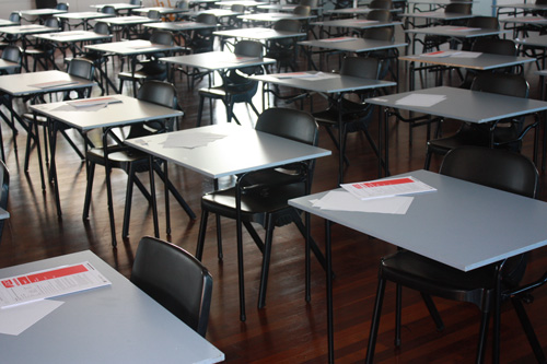 Tables and chairs in school hall.